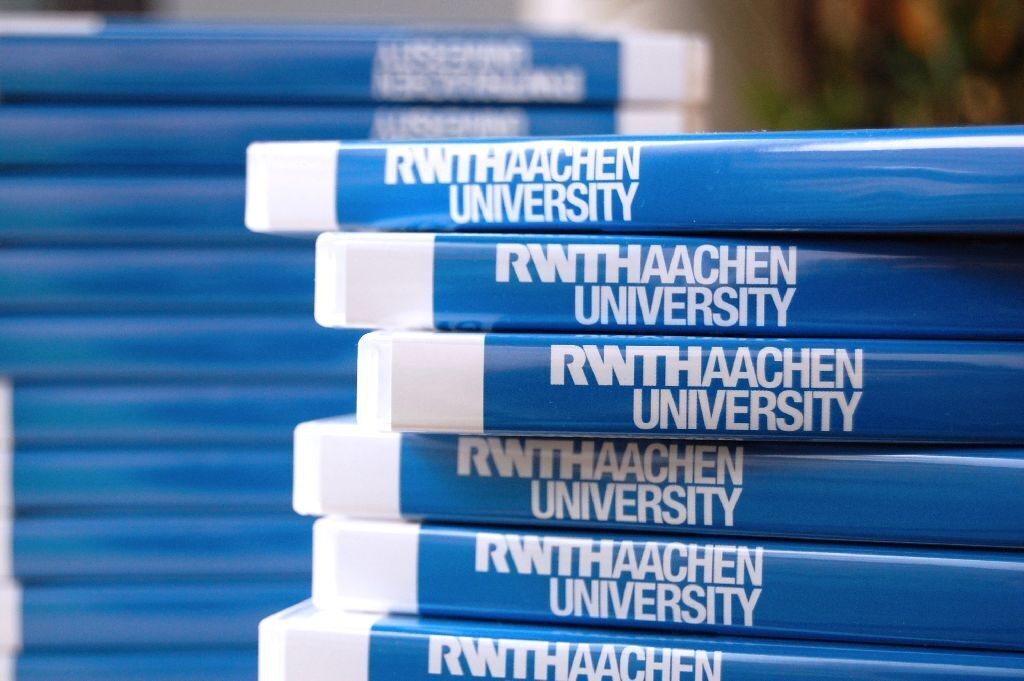 Stack of DVD cases with RWTH logo