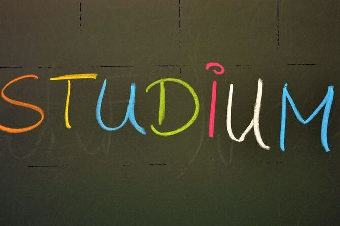 The word Studium in colorful letters on a chalkboard